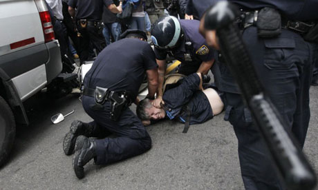 Police arrest a Legal Aid Society obsever on an Occupy Wall Street march