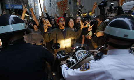 Occupy Wall Street protests confront police as they march in the Wall Street area in New York