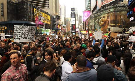Demonstrators associated with the Occupy Wall Street' movement protest in Times Square