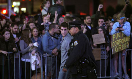 A police officer arrests an Occupy Wall Street protester during a demonstration at Times Square