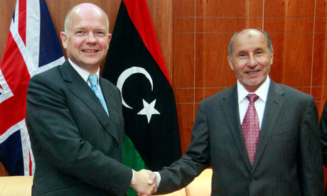 William Hague shakes hands with Mustafa Abdel Jalil during their meeting in Tripoli 17 October 2011
