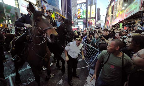 Occupy protests: Occupy Wall Street participants in Times Square in New York