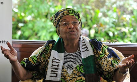 Liberia's president Ellen Johnson Sirleaf talks to the media at her house in Monrovia