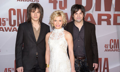 Reid Perry, Kimberly Perry and Neil Perry of The Band Perry attend the 45th annual CMA Awards