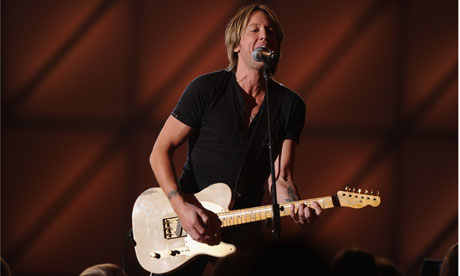 Keith Urban performs onstage at the 45th annual CMA Awards