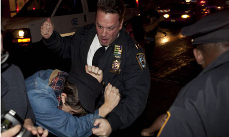 A police officer bundles away an Occupy Wall Street protester after the clear-out of Zuccotti Park
