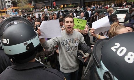 Protesters brandish copies of a court order outside Zuccotti Park
