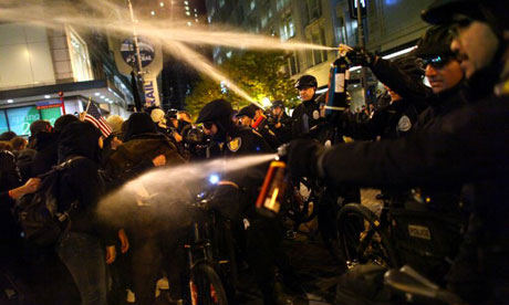 Seattle police officers deploy pepper spray into a crowd during an Occupy Seattle protest.
