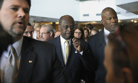 Herman Cain in a scuffle with journalists