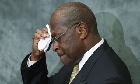 Herman Cain mops his brow