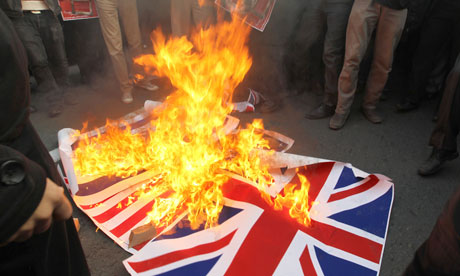 Iranian protesters burn the union flag outside the British embassy in Tehran