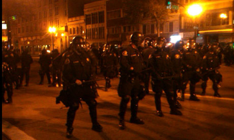 Police in riot gear stand on the streets during Occupy Oakland protests