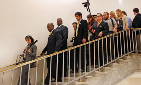 Herman Cain trailed by reporters