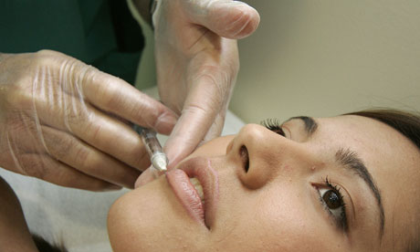A woman receiving a treatment at a cosmetic surgery practice