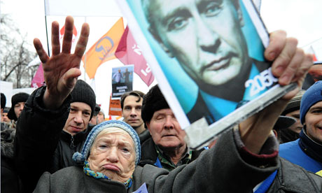 A Russian woman holds an anti-Putin placard in Bolotnaya square