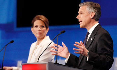 Republican presidential candidate Jon Huntsman speaks as Michele Bachmann listens