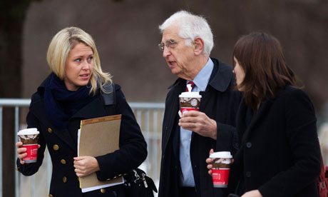 Jennifer Robinson, Daniel Ellsberg, talk outside the courthouse at Fort Meade in Maryland