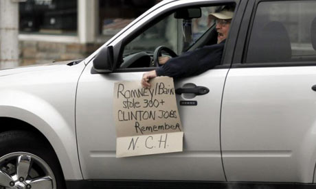 Protester outside Mitt Romney event in Iowa
