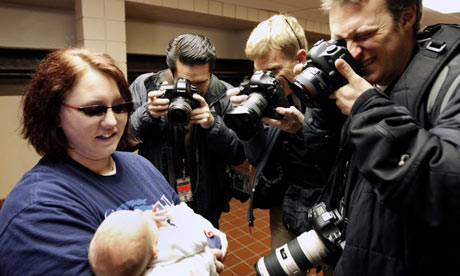 Baby and photographers in Iowa