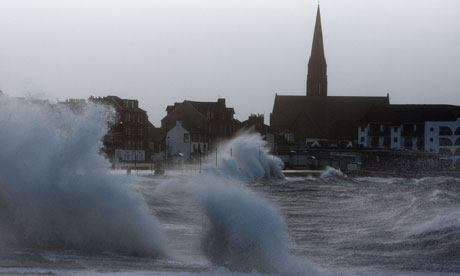 The promenade in Largs, Ayrshire is hit by waves going over the road as severe storms hit Scotland,