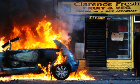 A burning car in Hackney, London, during riots on 8 August 2011.
