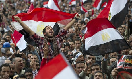 Protesters wave flags in Tahrir Square