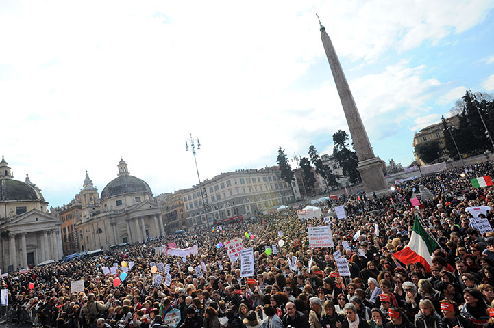 http://static.guim.co.uk/sys-images/Guardian/Pix/pictures/2011/2/15/1297781968282/Protesters-gather-in-Rome-004.jpg