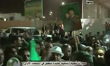 Footage broadcast by Libya's state television showing Libyans holding portraits of Muammar Gaddafi