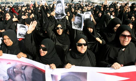 Hundreds of Bahraini protesters shout slogans as the attend the funeral of Fadel Salman Matrouk