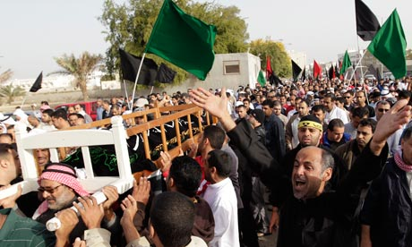 Bahrani anti-goverment protesters carry coffin of Ali Massour Khodier, in Sitra village, Bahrain