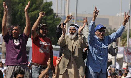 Bahraini anti-government protesters chant slogans at the Pearl roundabout in Manama, Bahrain
