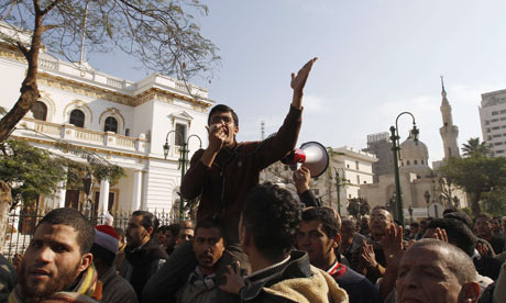 Egyptian anti-government protesters gather outside the Parliament gates in Cairo