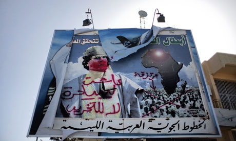 A vandalised billboard of Muammar Gaddafi in Benghazi on 1 March 2011.