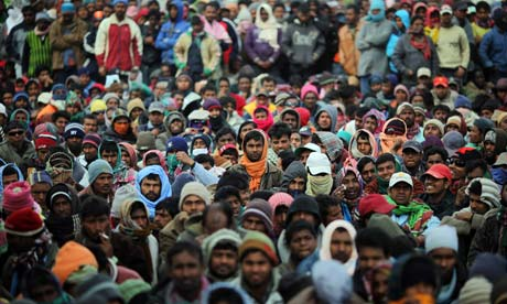 Men from Bangladesh wait patiently for information in Ras Jdir