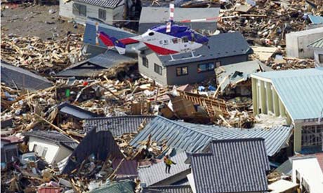 Japan tsunami: A victim is rescued by helicopter f