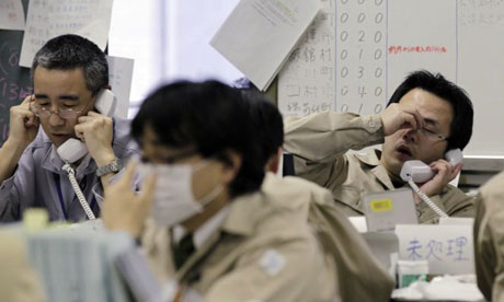 Japan nuclear crisis: workers at the disaster response headquarters in Fukushima, northern Japan