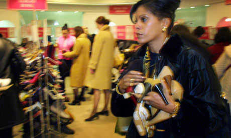 A shopper at the Harrods New Year sale