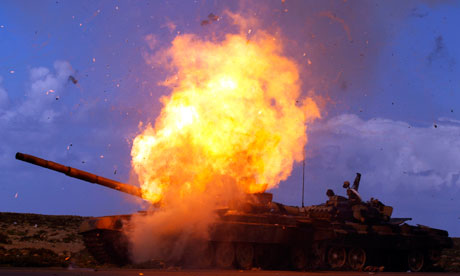 A tank belonging to forces loyal to Libyan leader Muammar Gaddafi explodes