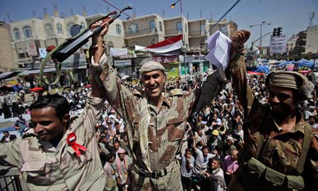 Yemeni army officers react as they join anti-government protestors in Sana'a, Yemen