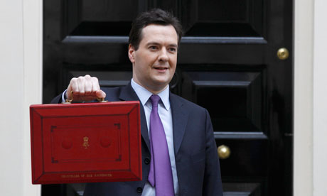Chancellor George Osborne holds his budget red box for the cameras in Downing Street