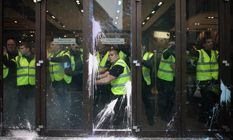 Topshop staff secure doors in Oxford St as police and protesters clash at anti-cuts march in London