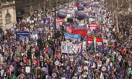 Anti-cuts protesters march in London on 26 March 2011