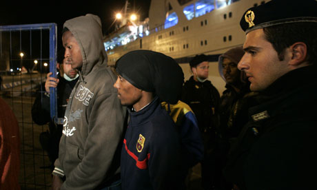 North African migrants arrive at the port in the southern Sicily village of Porto Empedocle