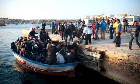Immigrants from Tunisia arrive on a boat to the sea port in Lampedusa, Italy