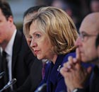 Hillary Clinton speaks and David Cameron listens during the London Conference on Libya.