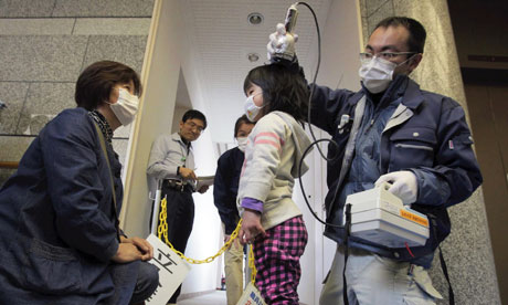 A girl is screened in Iitate, about 40km from the damaged Fukushima nuclear plant, where high levels of radiation have been detected. Photograph: Takumi Harada/AP
