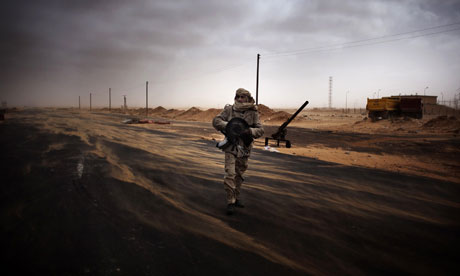 A Libyan rebel fighter mans a checkpoint