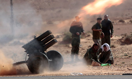 Anti-Libyan Leader Muammar Gaddafi rebels fire multiple launcher rockets