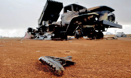 A lost combat boot lies in the sand in Benghazi, Libya