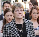 The family of Ian Tomlinson led by his wife Julia arrive at the inquest into his death 12 April 2011